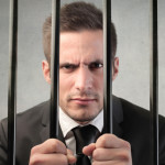 man-business-suit-prison-shutterstock